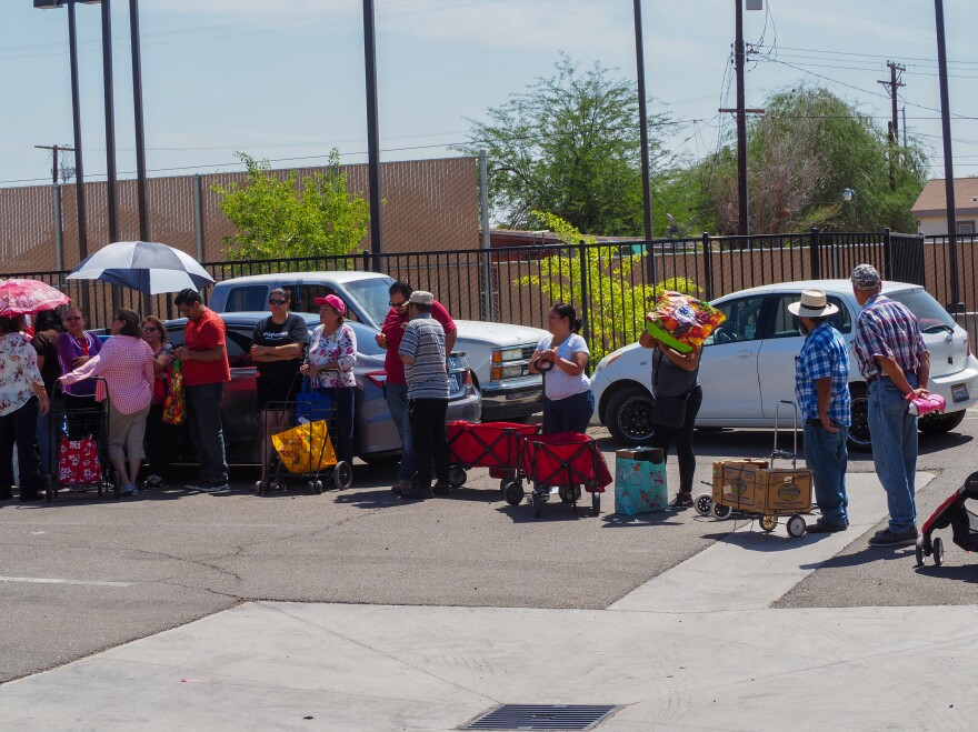 Every month, a food bank is set up at the community center in Heber, and some 250 families line up for free food.