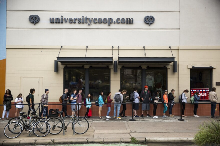 Voters line up outside of The University Co-op across from UT Austin on Election Day in November 2016.