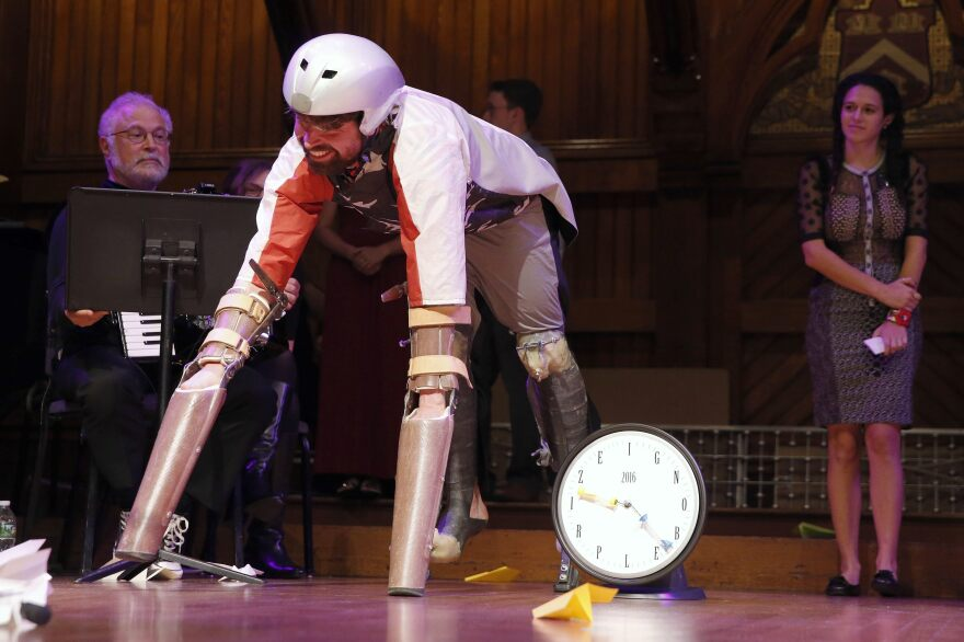 Thomas Thwaites, in his goat suit, prepares to speak after receiving the Ig Nobel prize in biology from Nobel laureate Eric Maskin (economics, 2007) during ceremonies at Harvard University on Thursday.