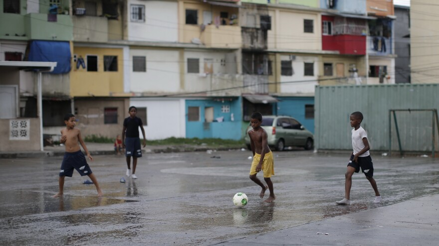 Children in a poor Panama City neighborhood play soccer on May 14. The Panama Canal has brought rapid development to the capital in recent years, but 40 percent of the country's residents still live in poverty.
