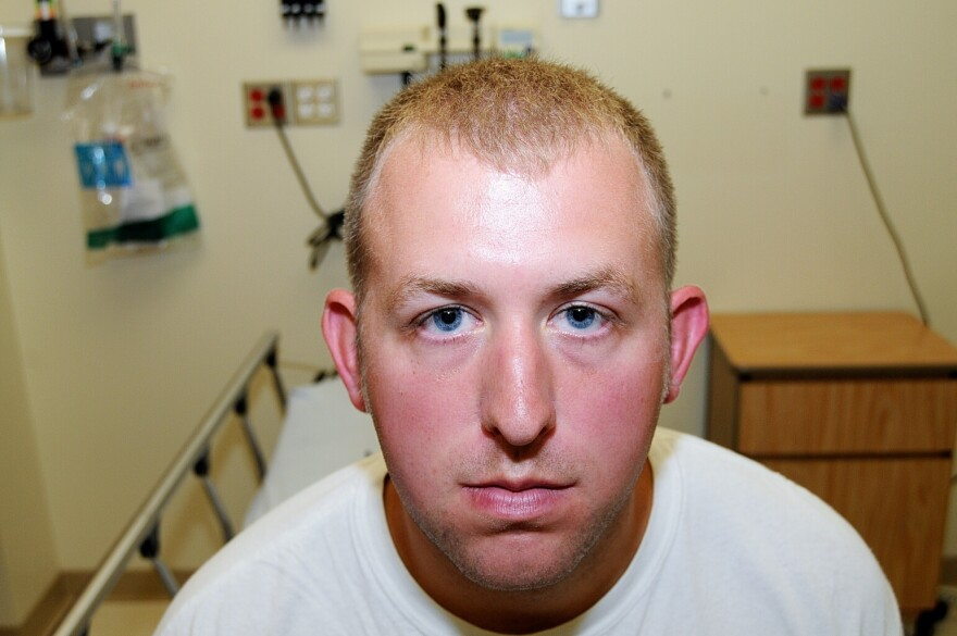 This undated photo released by the St. Louis County Prosecuting Attorney's office on Monday shows Ferguson police Officer Darren Wilson during his medical examination after he fatally shot Michael Brown.