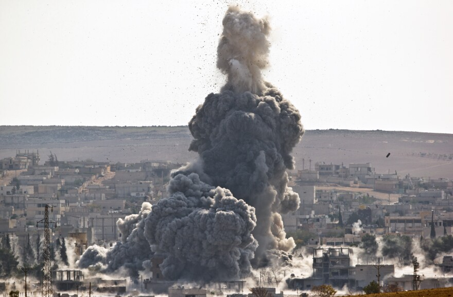 A U.S. airstrike hits an Islamic State position in the northern Syrian town of Kobani on Wednesday. The U.S. has carried out hundreds of airstrikes in Iraq and Syria since August, but the Islamic State has suffered only limited setbacks so far.