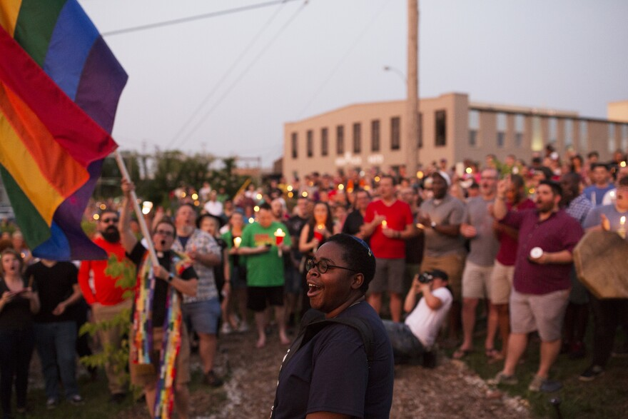 K.B. Frazier drums and leads a chant as marchers arrive at the Transgender Memorial Garden.