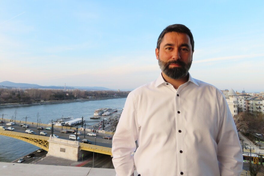 "At his office in Fidesz headquarters overlooking the Danube in Budapest, party spokesman Balazs Hidveghi defends the anti-Brussels billboards. ""We see a deliberate, pro-migration campaign in the European Commission,"" he says."