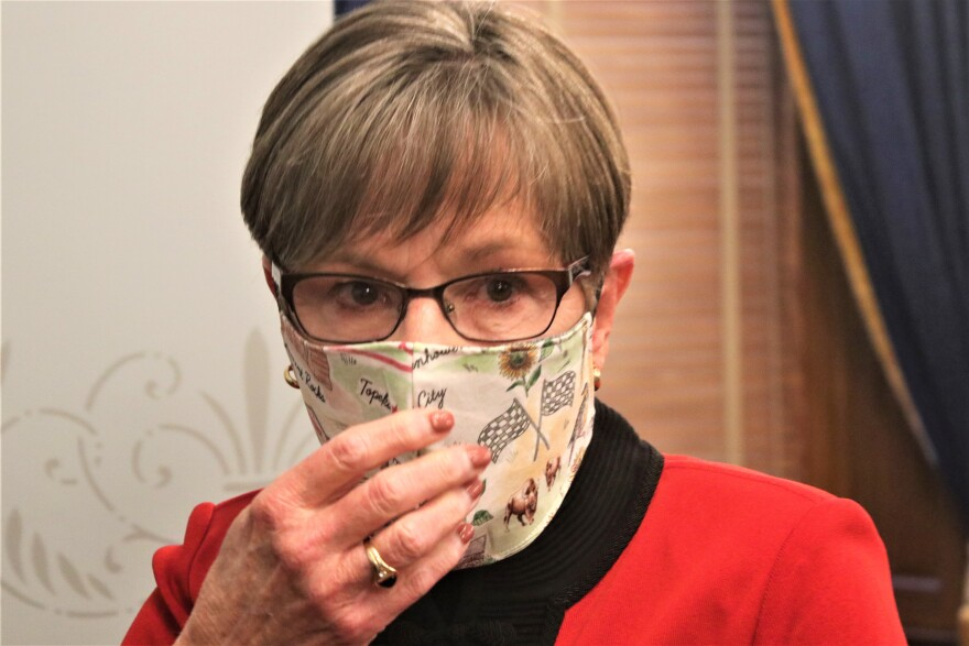 Kansas Gov. Laura Kelly, shown here in March, says she knows people don't like to wear masks but that until there's a vaccine, she doesn't believe there is an option.
