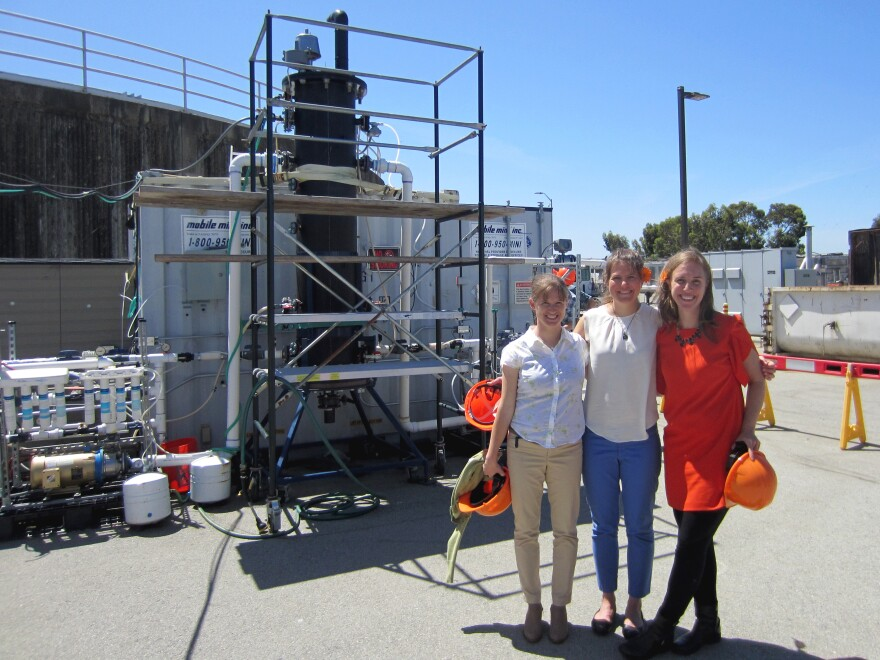 Anne Schauer-Gimenez (from left) Allison Pieja and Molly Morse of Mango Materials stand next to the biopolymer fermenter at a sewage treatment plant next to San Francisco Bay. The fermenter feeds bacteria the methane they need to produce a biological form of plastic.