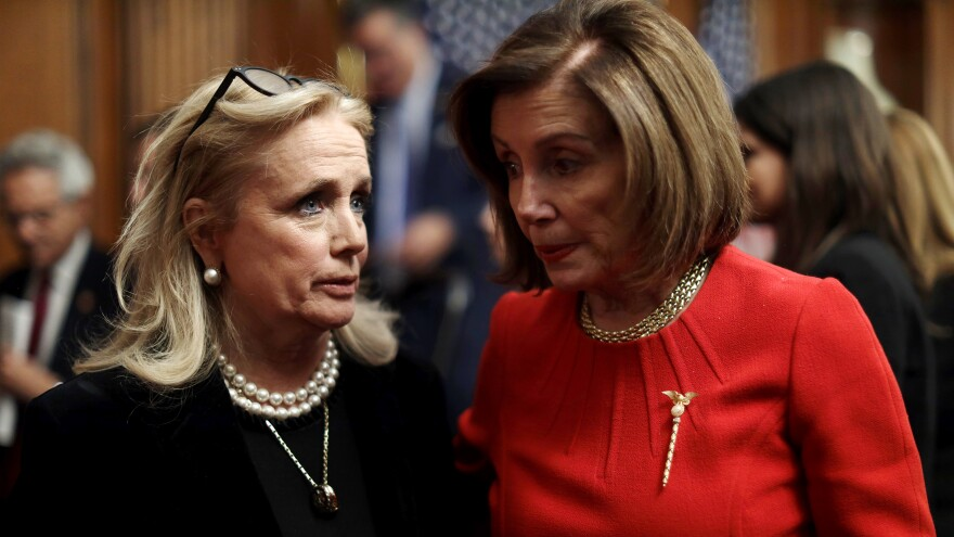 Speaker Nancy Pelosi talks to Rep. Debbie Dingell in the Capitol on Dec. 19.