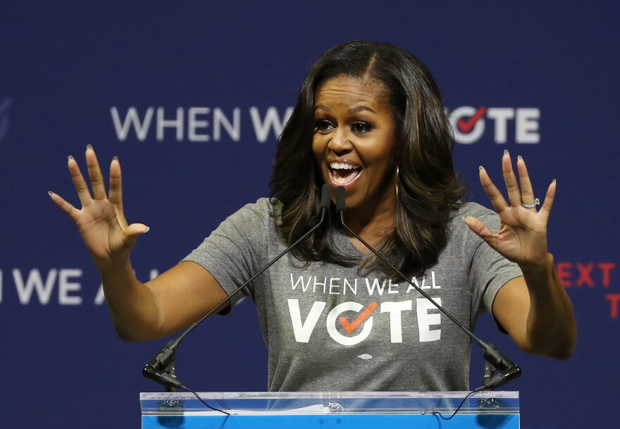 Former first lady Michelle Obama, seen here at a rally in 2018, is the founder of When We All Vote, an organization that aims to help people register and vote.
