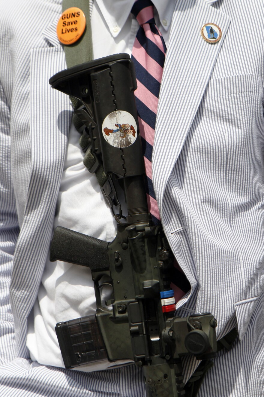 A gun advocate displays his rifle across his chest in protest at a gun control rally at the Georgia State Capitol last June. Gun rights activists in Georgia have been trying for years to pass versions of the Safe Carry Protection Act, which will go into effect in the state on July 1.