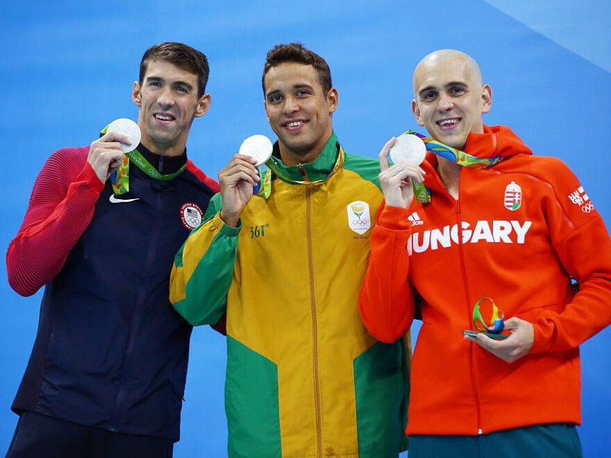 Joint silver medalists, (R-L) Michael Phelps of United States, Chad Guy Bertrand le Clos of South Africa and Laszlo Cseh of Hungary celebrate winning silver in the Men's 100m Butterfly Final on Day 7 of the Rio 2016 Olympic Games at the Olympic Aquatics Stadium on August 12, 2016 in Rio de Janeiro, Brazil.