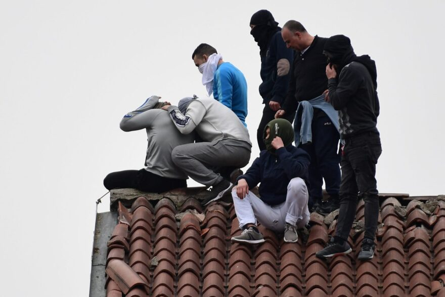 Inmates stage a protest on a rooftop of a wing at the San Vittore prison in Milan in one of Italy's quarantine red zones. Inmates in four Italian prisons have revolted over new rules introduced to contain the coronavirus outbreak.