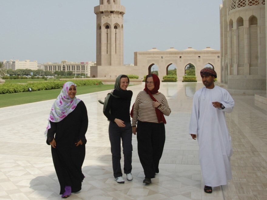 In this photo released by the U.S. Embassy in Oman, Sarah Shourd (second from left) visited the Sultan Qaboos Grand Mosque in Muscat after her release from Iran last year.