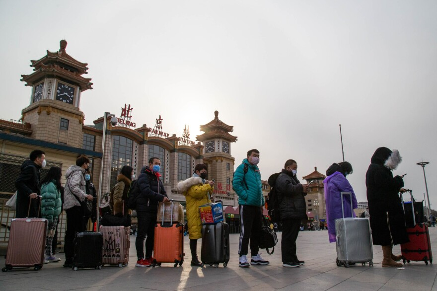 Travelers wait for taxis at the Beijing's train station.