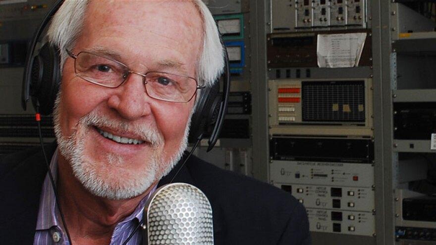 Wayne bledoe in radio studio with mic