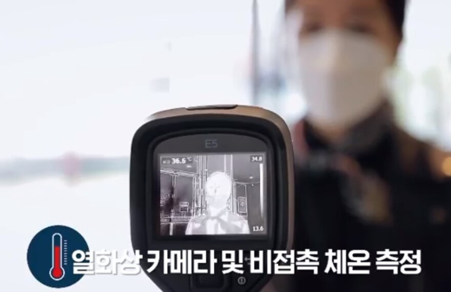 """This image from a South Korean video shows theatergoers what to expect before they enter """"Phantom of the Opera,"""" including a thermal scan to detect a fever."""