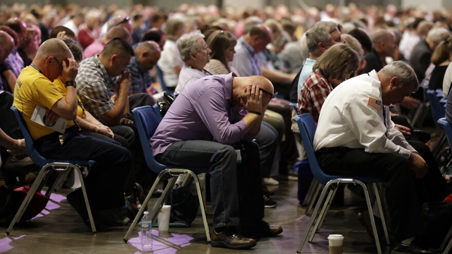 Delegates at prayer during the annual meeting of the Southern Baptist Convention in St. Louis.