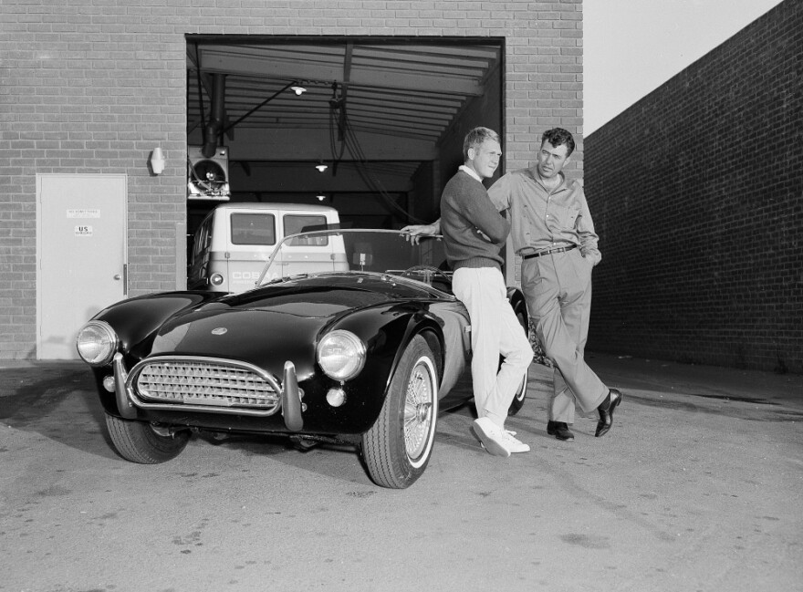 Actor Steve McQueen, left, and racer Carroll Shelby stand by McQueen's Ford-Cobra roadster, June 28, 1963, in Los Angeles.