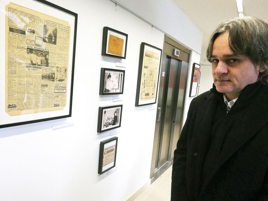 "Laurent ""Riss"" Sourisseau, a French cartoonist and publishing director of <em>Charlie Hebdo</em>, attends the inauguration of an exhibitat the Duduchothèque, in Chalons-en-Champagne, northeastern France, in December 2018."