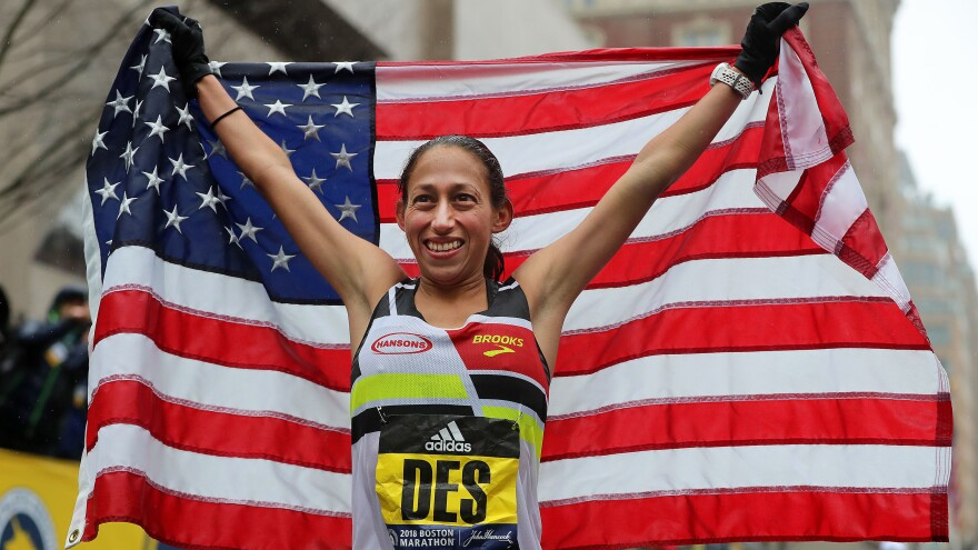 Boston Marathon women's winner Desiree Linden celebrates after she crosses the finish line on Monday.