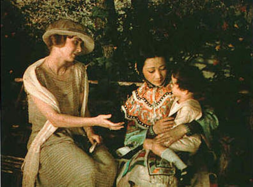 Anna_May_Wong_holds_child_in_The_Toll_of_the_Sea.jpg