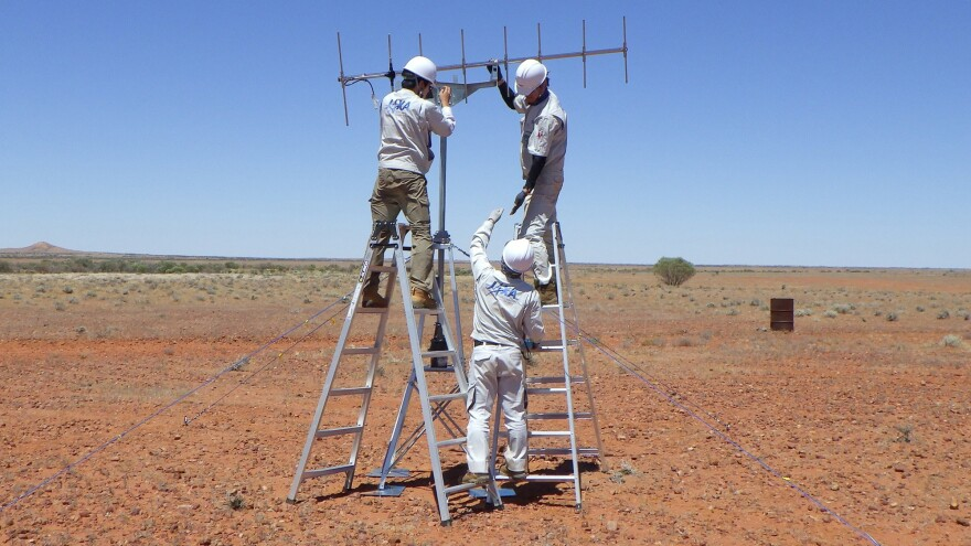 JAXA crew members set up antennas last month in Woomera, South Australia. The setup is meant to help researchers locate a proverbial needle in a haystack after the sample lands.