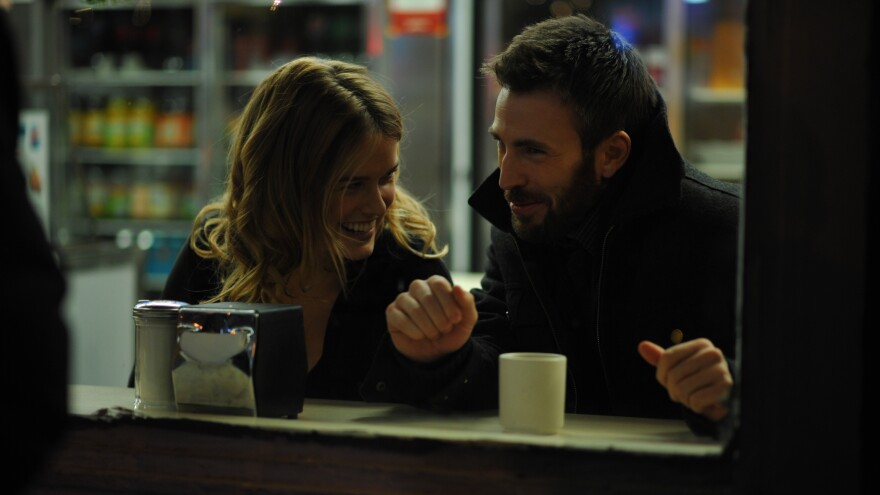 Alice Eve and Chris Evans play two strangers who happen upon each other at Grand Central Station in <em>Before We Go</em>.