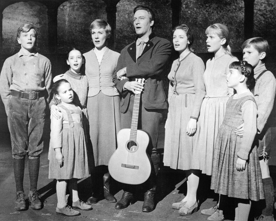 Christopher Plummer, center, did not particularly relish his role as retired naval officer Captain Von Trapp in <em>The Sound Of Music.</em>