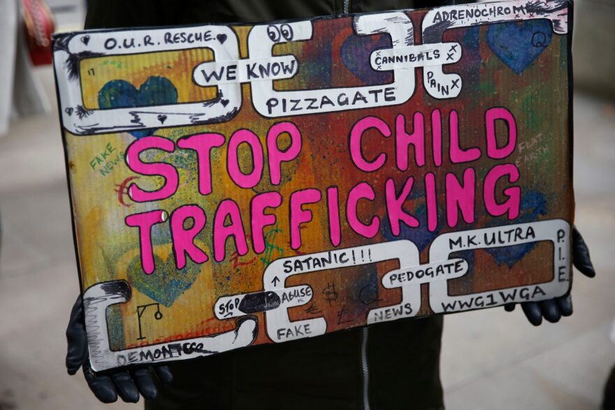 "A protestor holds a sign during a ""Save our Children"" rally outside Downing Street in London, England. Conspiracy theorists have recently coopted #SaveTheChildren to find new followers."