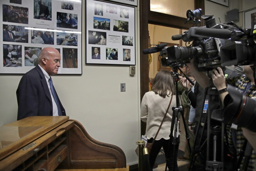 New Hampshire Secretary of State Bill Gardner, left, as he waits for a presidential candidate to to file to be placed on the New Hampshire primary ballot. Gardner is the long-serving top election official in the country and has been accused of downplaying election security.