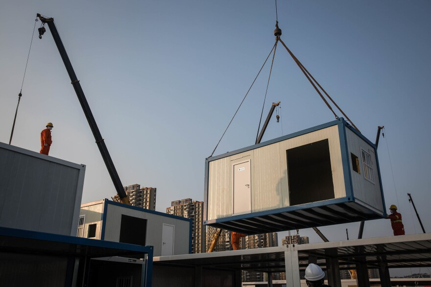 The prefabricated patient bedrooms are built off-site and then brought in and stacked up. This photo is from Jan. 30.