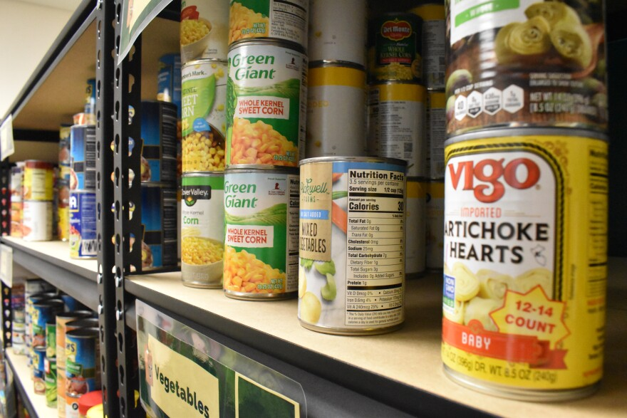 Canned foods line the shelves of the food pantry on the USF St. Petersburg campus.
