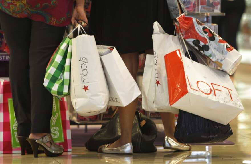 Shoppers look at a display at the Dadeland Mall in Miami on Nov. 25. Princeton professor Sheldon Garon says Americans spend too much and save too little compared to Europeans and Asians.