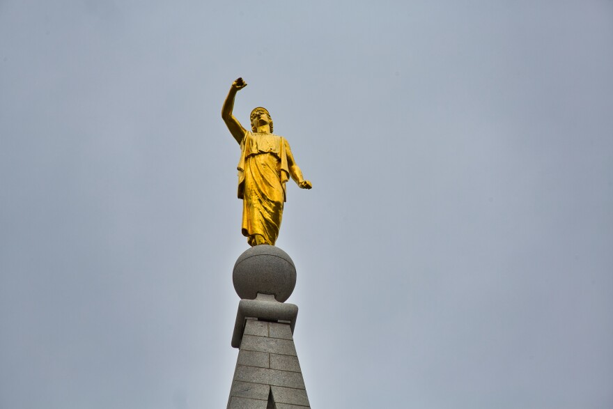 Photo of angel Moroni on top of the LDS Temple that shows the missing trumpet.