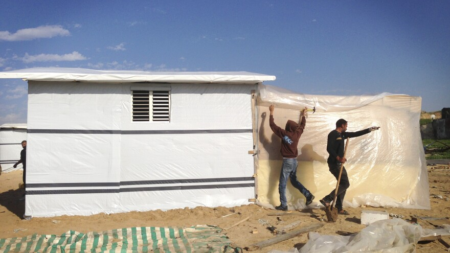 Some Gazans are building tiny new homes of wood and plastic because of the difficulty obtaining cement.