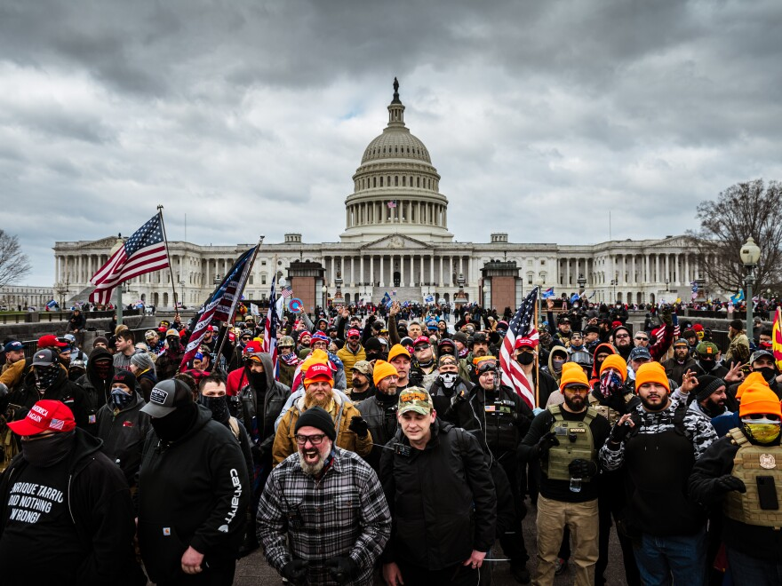 Pro-Trump protesters gathered in front of the U.S. Capitol on Wednesday. On social media sites both fringe and mainstream, right-wing extremists made plans for violence on January 6.