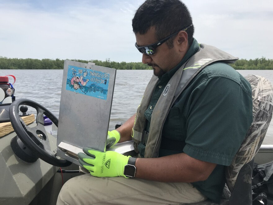 Fisheries management biologist Salvador Mondragon takes notes on the alligator gar sampling mission in May 2019.