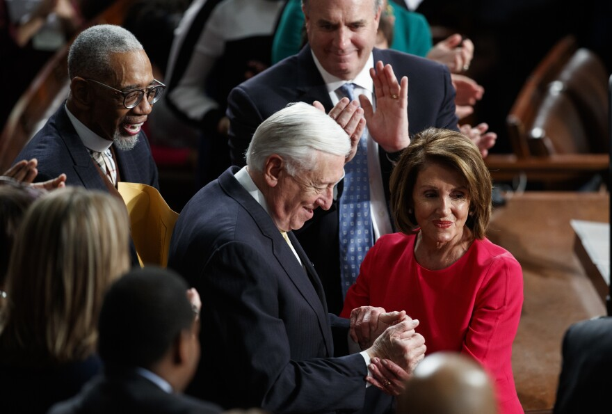 New Speaker of the House Nancy Pelosi, D-Calif., and House Majority Leader Steny Hoyer, D-Md., are applauded at the Capitol on Thursday as Democrats officially regain control of the chamber.
