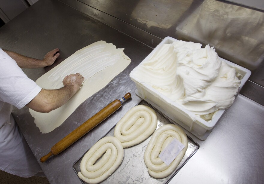 A baker prepares <em>ensaïmades</em>, a traditional sweet bread, at a bakery in Palma de Mallorca. The <em>ensaïmada</em> is a traditional Mallorcan dessert made with reduced pork lard.