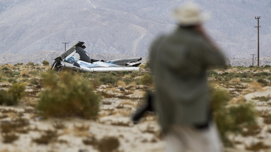Wreckage lies near the site where a Virgin Galactic SpaceShipTwo, crashed in Mojave, Calif., on Friday.