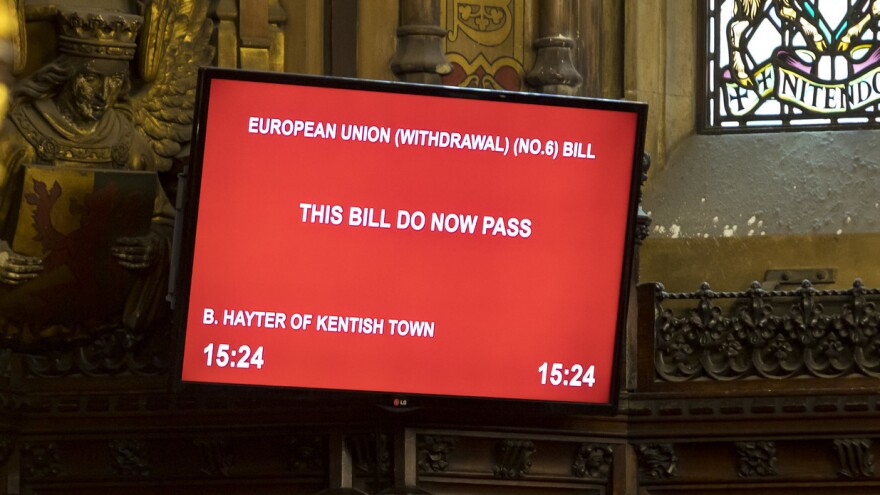 A monitor in the House of Lords shows its approval of a bill blocking a no-deal Brexit Friday.