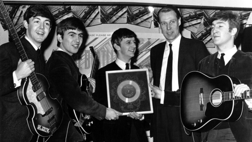 Producer George Martin (second from right) with The Beatles.