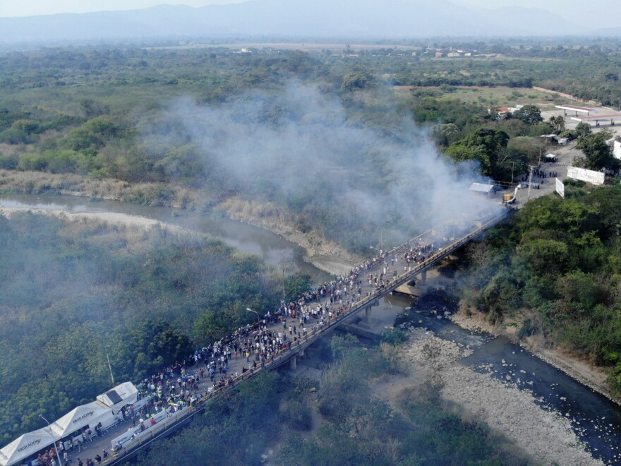 Smoke billows from aid trucks set on fire on the Francisco de Paula Santander International Bridge between Colombia and Venezuela on Feb. 23.