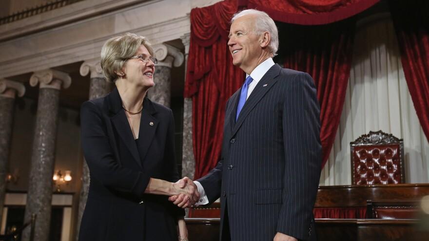 U.S. Sen. Elizabeth Warren participates in a re-enacted swearing-in with U.S. Vice President Joe Biden at the U.S. Capitol on Jan. 3, 2013.