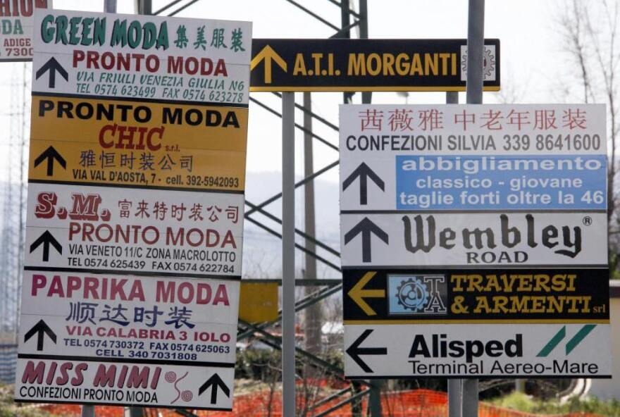 Street signs cater to the languages spoken in Prato.