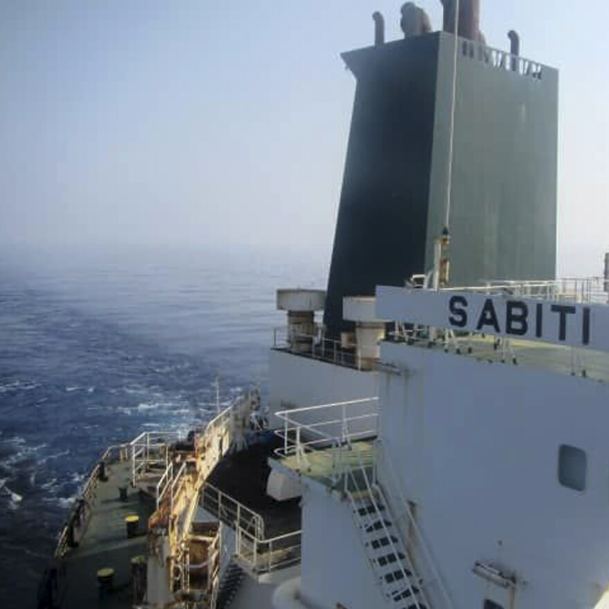 This photo released by the official news agency of the Iranian Oil Ministry, SHANA, shows Iranian oil tanker Sabiti traveling through the Red Sea on Friday. Iran says two missiles struck the tanker.