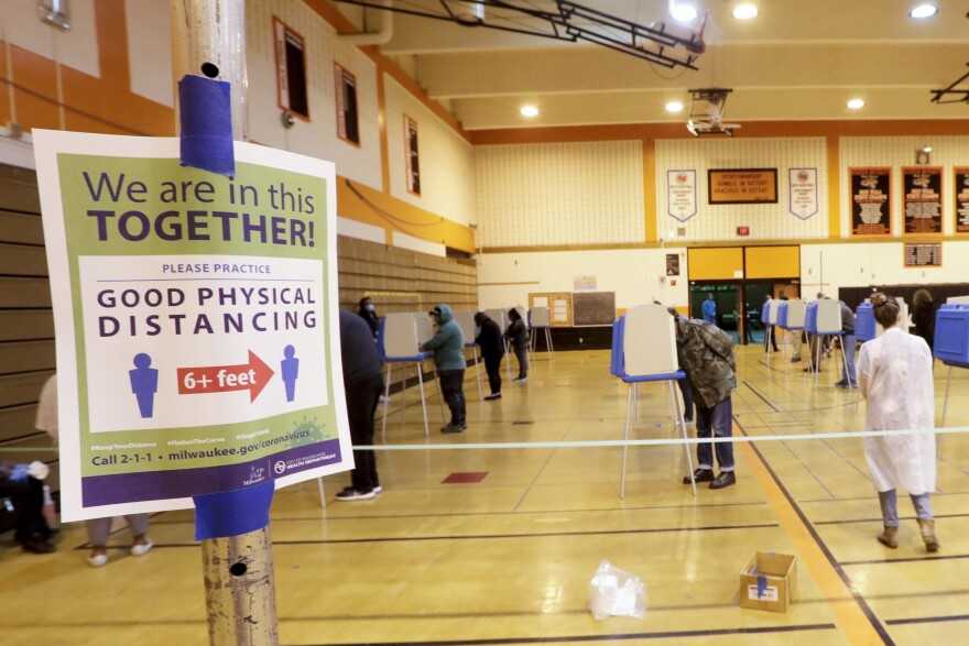 Voters cast ballots at Riverside High School during Wisconsin's primary election on Tuesday in Milwaukee. It's the only state to hold a major election since stay-at-home orders were issued across most of the country.