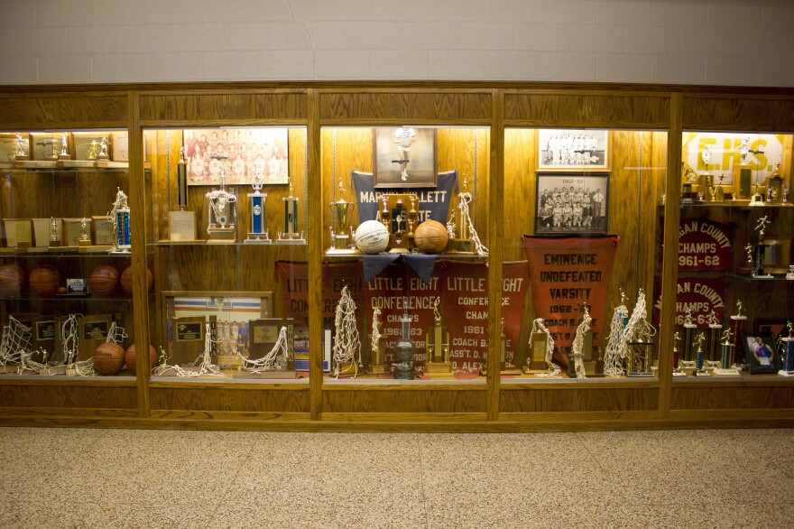 Trophy cases line the halls at Eminence Jr.-Sr. High School, a public school where enrollment has been dropping. Eminence is too small to field a football team.