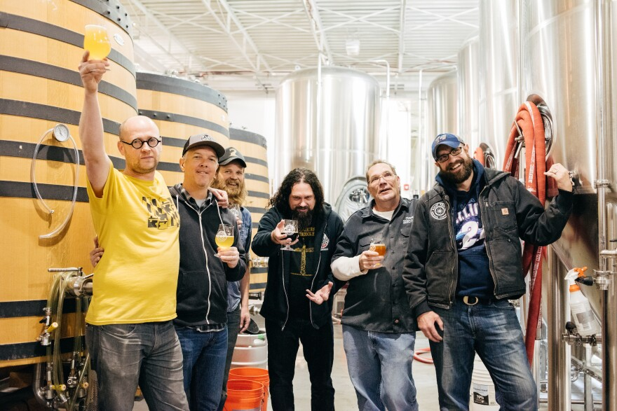"Sunn O)))'s Greg Anderson (center) mugs with brewers from Right Proper, Stone and Pen Druid to make ""Soused,"" a beer inspired by the drone-metal band's collaboration with Scott Walker."