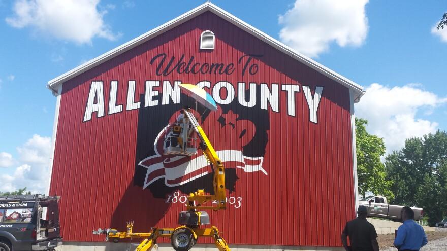 Barn artist Scott Hagan works on a barn at the Allen County Farm Park in Allen County, outside Lima.
