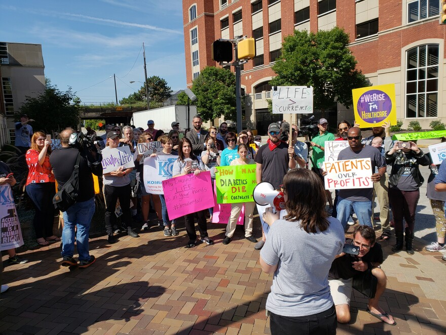 Elizabeth Pfiester, founder of T1International, addresses a crowd outside the Indianapolis headquarters of pharmaceutical giant Eli Lilly and Co. in September.